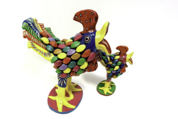 Brightly colored ceramic large chicken, $89. Small chicken, $31.50. Photo by Jessica Laudicina.