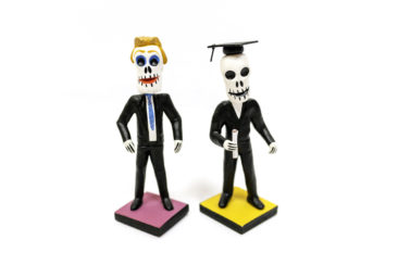 Day of the Dead man in tie, $19, and graduate, $18.50. Photo by Jessica Laudicina.
