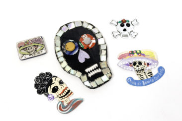 Large skull magnet, $18; Catrina magnet, $7.50; Skull and crossbones magnet, $3.50; Lady skeleton magnet, $11.50; Larger Catrina magnet, $11.50. Photo by Jessica Laudicina.