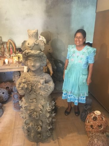 Irma Blanco with her ceramic sculptures in Santa Maria Atzompa, Oaxaca