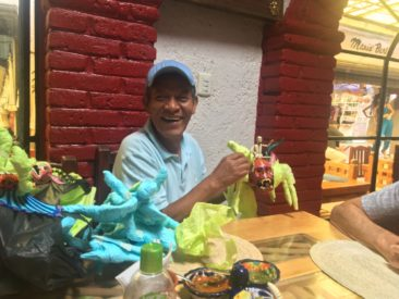 Joel Garcia unwrapping new sculptures at Ciudadela Market in Mexico City