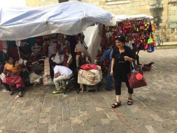 Julia strolls a market in Oaxaca, Mexico.