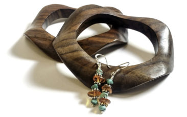 Wavy wooden bracelets, $36 each. Turquoise and amber earrings, $24. Photo by Jessica Laudicina.