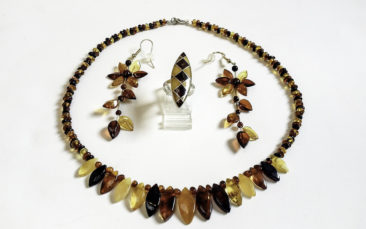 Multi-colored amber necklace, $61; flower earrings, $40; multi-colored amber ring, $58. Photo by Jessica Laudicina.