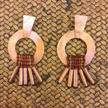 "Mapuche copper earrings with woven adornment, 2.5"" x 1.5"", $60."