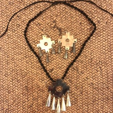 "Maupuche cross necklace, central piece reassures 2.25"" x 2"", $58, with earrings, 1.5"" x .75"", $28."