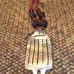 Mapuche necklace symbolic of a house with black beads and woven chord, $72.