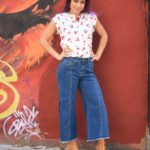 Jeans with open side detail by CURRENT AIR, $41; Cherry blouse by SM WARDROBE, $28
