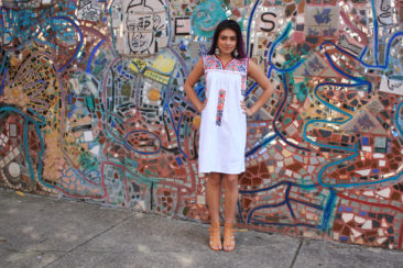 Embroidered Mexican dress, $160, Mexican heart milagro earrings with turquoise, $285