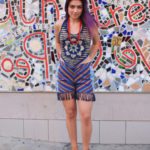 Halter top by JAYLI, $37; fringed shorts from the Philippines, $58; African red glass beaded necklaces, $48/each