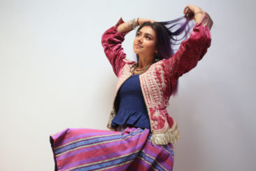 Vintage Bolivian jacket, $240; Navy tube top by COTTON CANDY LA, $23; Striped skirt from the Philippines, $95; Recycled kantha necklace by WORLD FINDS, $28