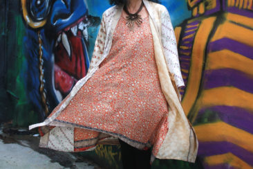 COLINE handkerchief hem tunic, $36; NUSANTARA recycled silk robe, $53; Twig and brass necklace from the Philippines, $26