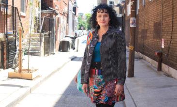 LITTLE JOURNEYS striped jean jacket, $72; COLINE print wrap skirt, $35; Moroccan crochet pom-pom earrings, $24.