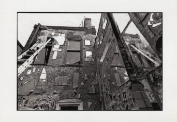 Isaiah Zagar working on exterior of Eye's Gallery. Photo courtesy of Julia and Isaiah Zagar.