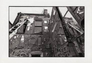 Isaiah Zagar working on exterior of Eye's Gallery. Photo courtesy of Julia and Isaiah Zagar.
