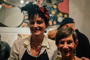Carole Shields, manager of Eye's Gallery, poses with Clara Hollander.