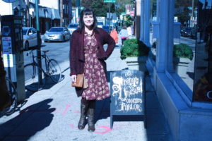 EFFIE'S HEART Louisa dress in photograph print, $110; ANGIE burgundy/black tweed sweater coat, $59; SHIR ALEAH pleather purse in rust, $54